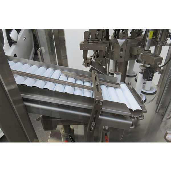Machine automatique de remplissage et de scellage de tubes de pommade pour peau douce